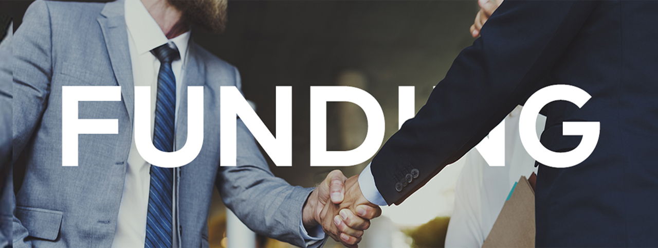 Two people shake hands, the photo intersected by the word 'Funding'
