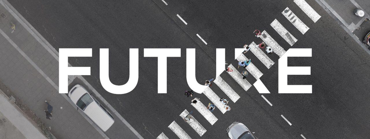 A zebra crossing from above, the image intersected by the word 'Future'