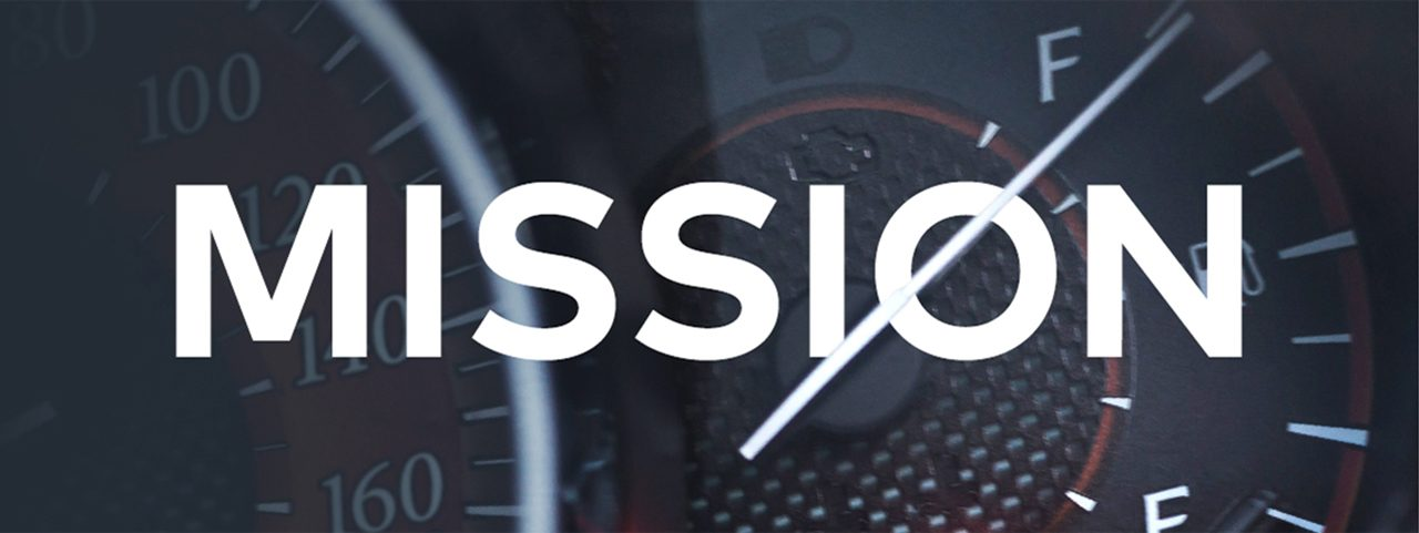 A car dashboard, intersected by the word 'Mission'