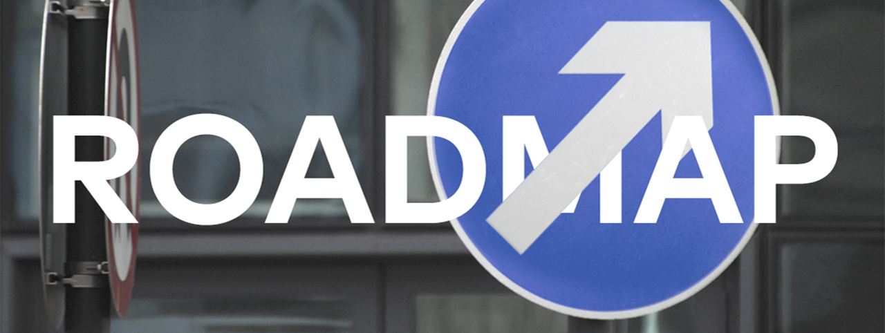 Two UK road signs, the image intersected by the word 'Roadmap'