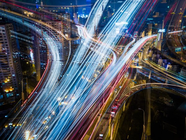 A highway from above, taken with a slow shutter speed to capture streaks of car lights