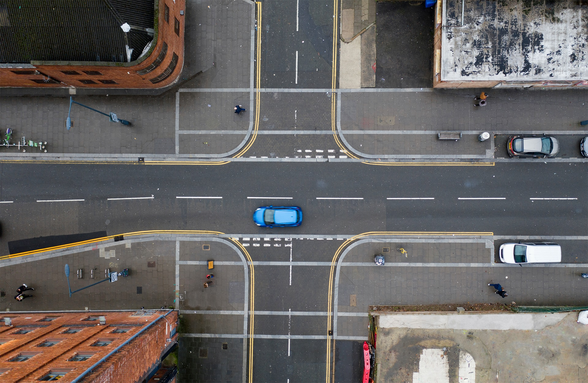 A car drives over a crossroads, the photo is taken from above